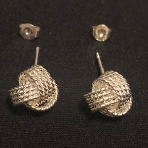 Jewelry - Silver knot earrings. Never worn. Silver. Posts